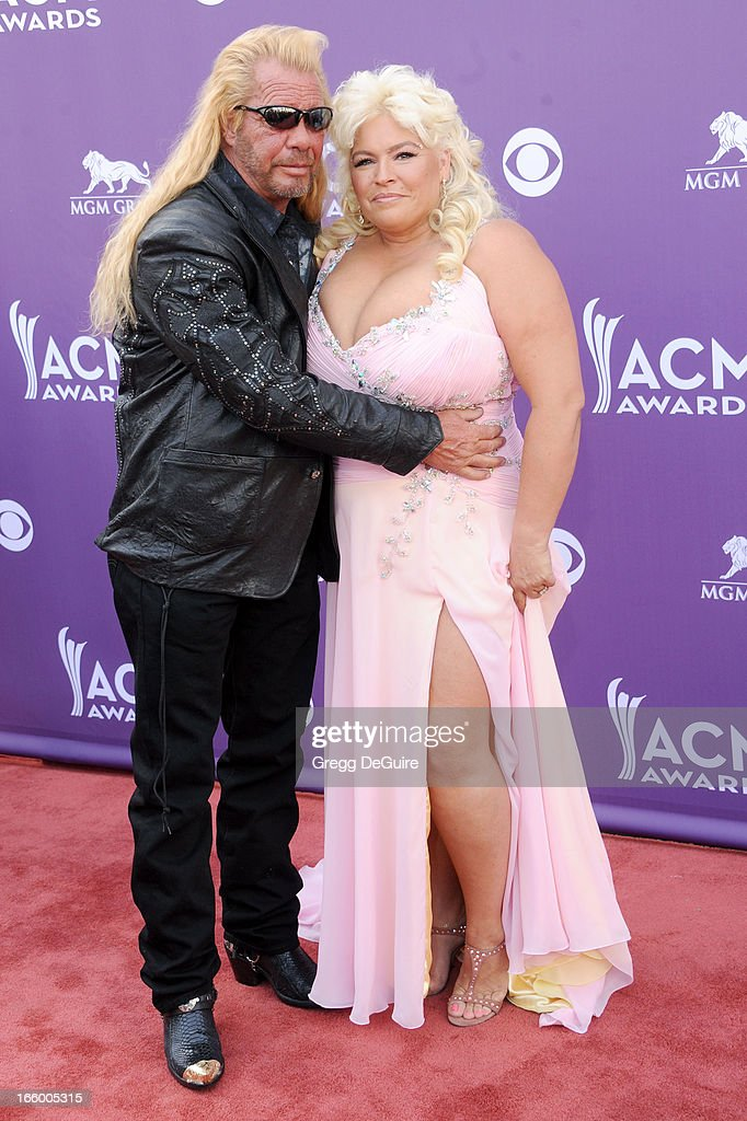 TV personalities Duane Lee 'Dog' Chapman and Beth Chapman of Dog the Bounty Hunter arrive at the 48th Annual Academy Of Country Music Awards at MGM Grand Garden Arena on April 7, 2013 in Las Vegas, Nevada.