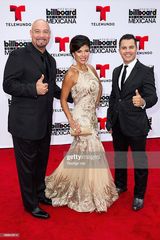 TV personalities Edgar Lopez, Mirella Grisales and Karim Mendiburu attend the 2013 Billboard Mexican Music Awards arrivals at Dolby Theatre on October 9, 2013 in Hollywood, California.