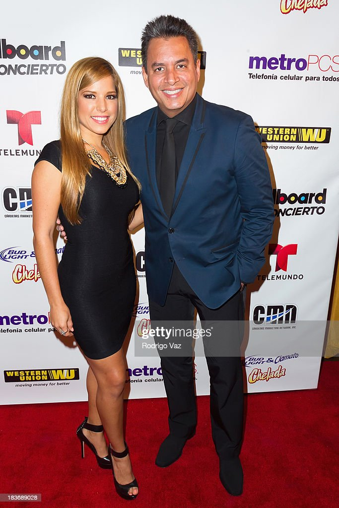 TV personalities Elva Saray (L) and Daniel Sarcos attend Billboard In Concert Series presents Calibre 50 at The Conga Room at L.A. Live on October 8, 2013 in Los Angeles, California.