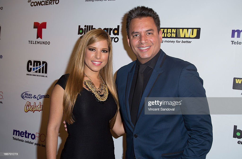 TV personalities Elva Saray (L) and Daniel Sarcos attend Billboard In Concert Series presents Calibre 50 at The Conga Room at The Conga Room at L.A. Live on October 8, 2013 in Los Angeles, California.