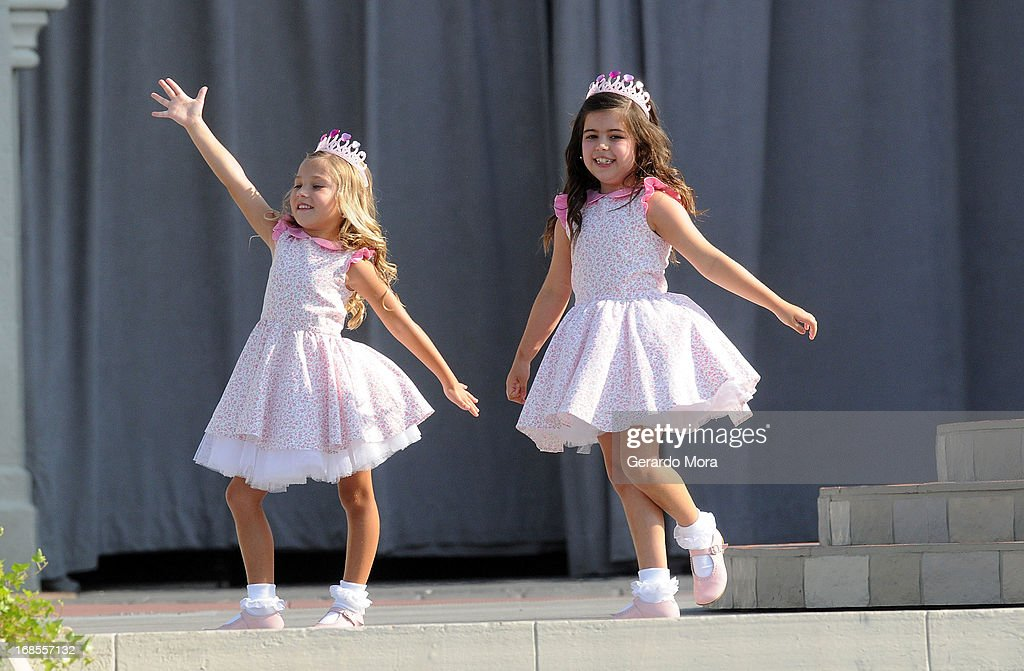 TV personalities from ÒThe Ellen DeGeneres ShowÓ Rosie McClelland (L) and Sophia Grace Brownlee perform during a royal celebration at the Magic Kingdom at Walt Disney World Resort in conjunction with Mother's Day festivities on May 11, 2013 in Lake Buena Vista, Florida.