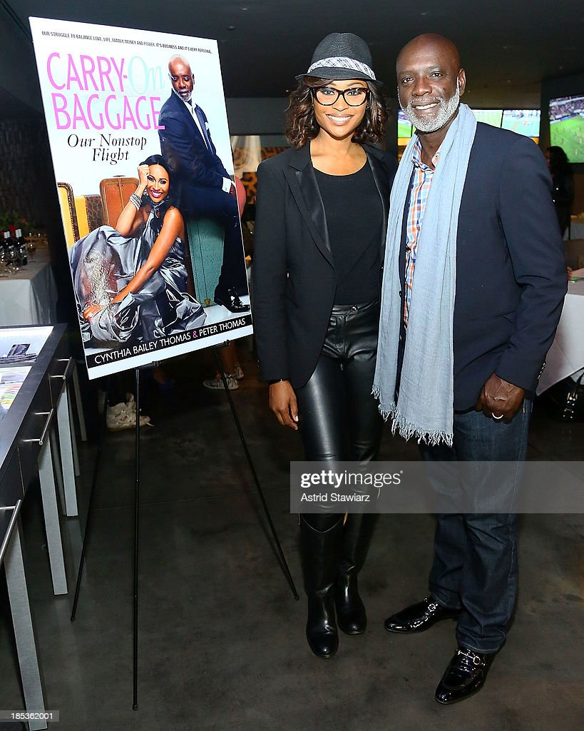 TV personalities from The Real Housewives of Atlanta, Cynthia Bailey-Thomas And Peter Thomas attend the 'Carry-On Baggage, Our Non-Stop Flight' book launch event at Clyde Frazier's Wine and Dine on October 19, 2013 in New York City.