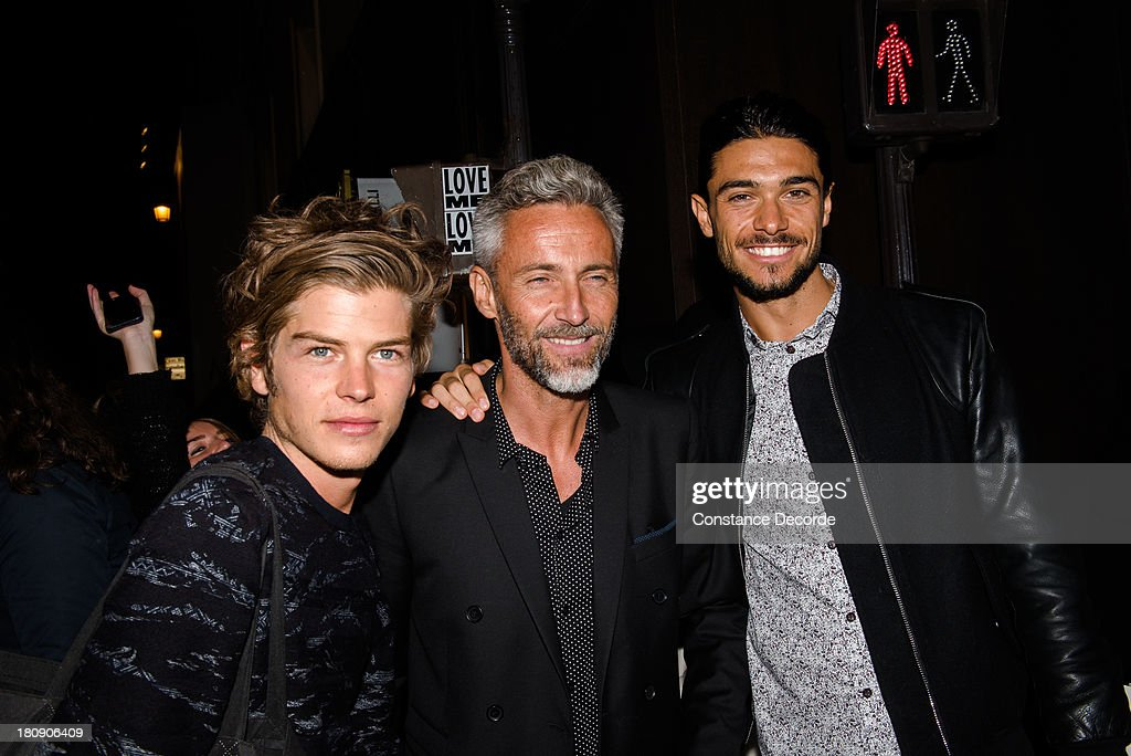 TV personalities Gautier, Ben and Julien from 'Secret Story' pose at Colette during Vogue Fashion Night on September 17, 2013 in Paris, France.