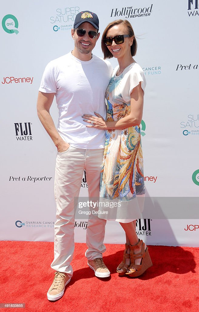 TV personalities Giuliana Rancic and Bill Rancic arrive at the Ovarian Cancer Research Fund's Inaugural Super Saturday LA event at Barker Hangar on May 17, 2014 in Santa Monica, California.