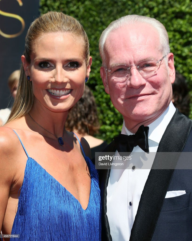 TV personalities <a gi-track='captionPersonalityLinkClicked' href=/galleries/search?phrase=Heidi+Klum&family=editorial&specificpeople=178954 ng-click='$event.stopPropagation()'>Heidi Klum</a> (L) and <a gi-track='captionPersonalityLinkClicked' href=/galleries/search?phrase=Tim+Gunn&family=editorial&specificpeople=696109 ng-click='$event.stopPropagation()'>Tim Gunn</a> attend the 2014 Creative Arts Emmy Awards at the Nokia Theatre L.A. Live on August 16, 2014 in Los Angeles, California.