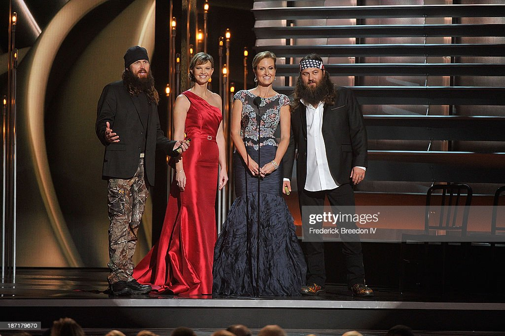 TV Personalities Jace Robertson, Melissa Robertson, Korie Robertson and Willie Robertson from the hit show 'Duck Dynasty' on stage during the 47th annual CMA awards at the Bridgestone Arena on November 6, 2013 in Nashville, Tennessee.