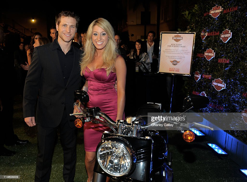TV personalities Jake Pavelka and Vienna Girardi turn the key on a Harley-Davidson to raise money for Harley's Heroes at the 2010 Maxim Hot 100 Party held at Paramount Studios on May 19, 2010 in Los Angeles, California.
