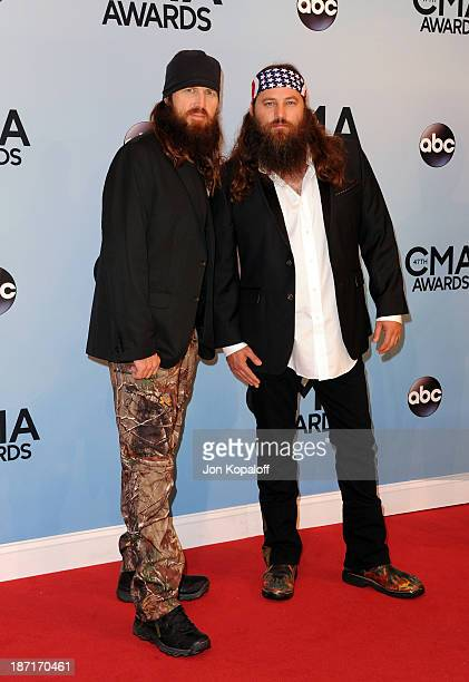 TV Personalities Jase Robertson and Willie Robertson of the hit show 'Duck Dynasty' attend the 47th annual CMA Awards at the Bridgestone Arena on...