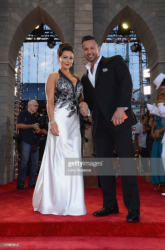 TV personalities Jenni 'Jwoww' Farley (L) and Roger Mathews attend the 2013 MTV Video Music Awards at the Barclays Center on August 25, 2013 in the Brooklyn borough of New York City.