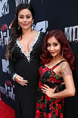 TV personalities Jennifer 'JWoww' Farley and Nicole 'Snooki' Polizzi attend the 2014 MTV Movie Awards at Nokia Theatre LA Live on April 13 2014 in...