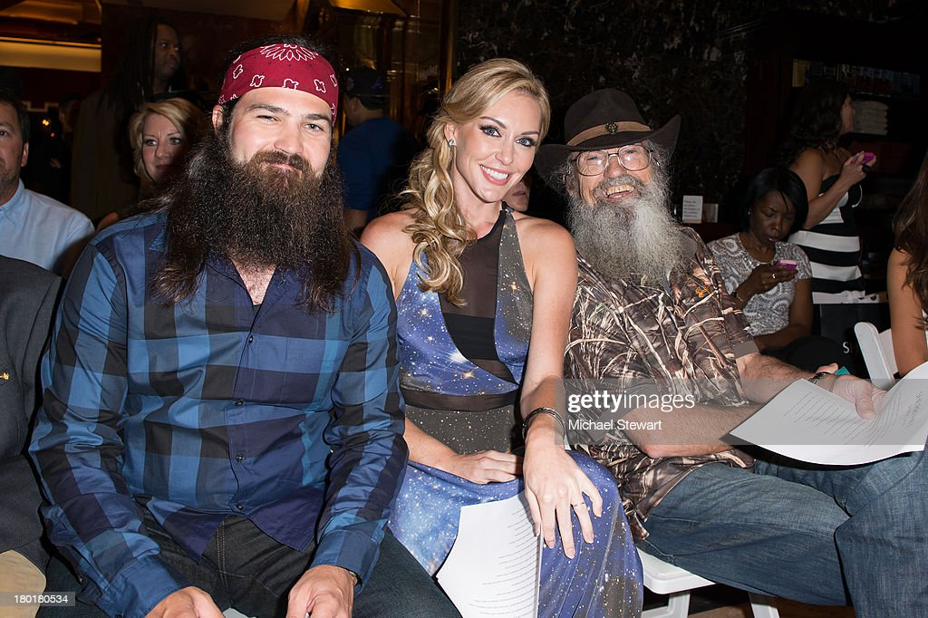 TV personalities Jep Robertson, Jessica Robertson and Silas Merritt 'Si' Robertson attend the Evening By Sherri Hill Spring 2014 show at Trump Tower on September 9, 2013 in New York City.