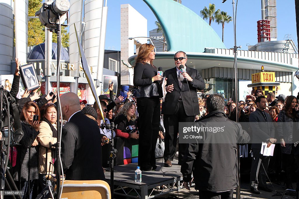 TV Personalities Jessica Maldonado (L) and Raul De Molina broadcast a special edition of their tv show 'El Gordo y la Flaca' outside the Gibson Amphitheater during Jenni Rivera Celestial Graduation at Universal City Walk on December 19, 2012 in Universal City, California.