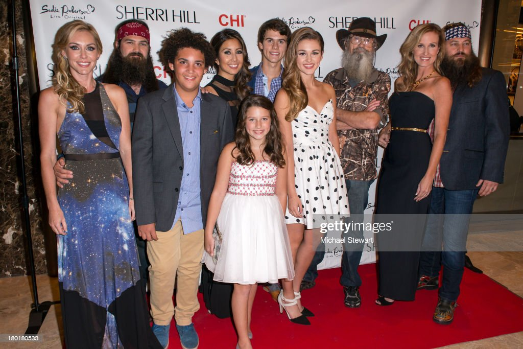 TV personalities Jessica Roberston, Jep Robertson, Will Robertson, Rebecca Robertson, Bella Robertson, John Luke Robertson, Sadie Robertson, Silas Merritt 'Si' Robertson, Korie Robertson and Willie Robertson attend the Evening By Sherri Hill Spring 2014 show at Trump Tower on September 9, 2013 in New York City.