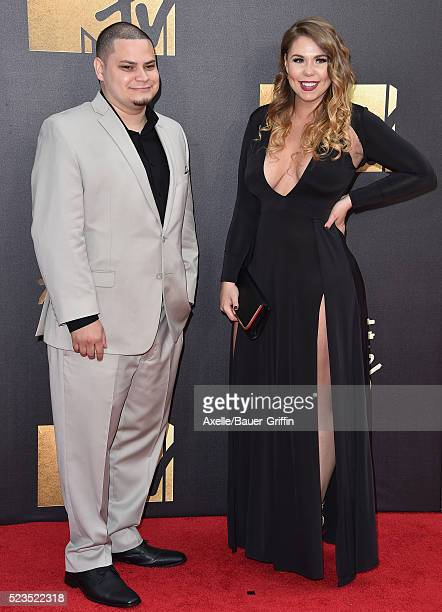 TV personalities Jo Rivera and Kailyn Lowry arrive at the 2016 MTV Movie Awards at Warner Bros Studios on April 9 2016 in Burbank California