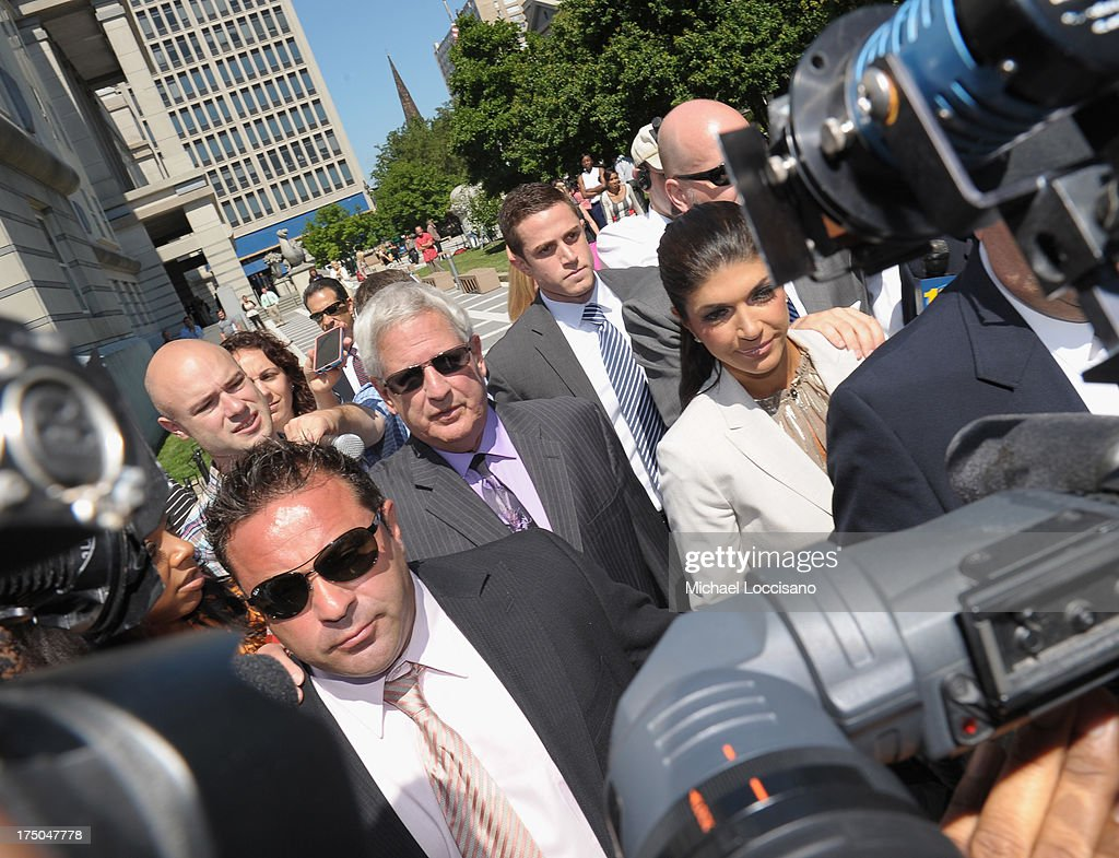 TV personalities Joe Giudice and Teresa Giudice appear in court to face charges of defrauding lenders, illegally obtaining mortgages and other loans as well as allegedly hiding assets and income during a bankruptcy case on July 30, 2013 in Newark, United States.