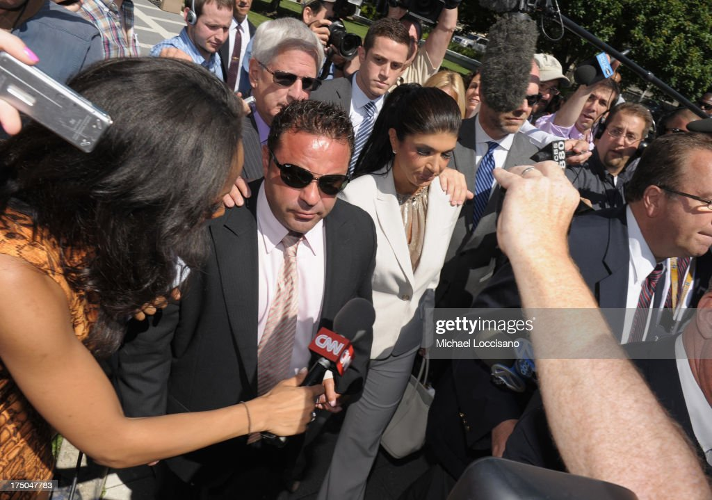 TV personalities <a gi-track='captionPersonalityLinkClicked' href=/galleries/search?phrase=Joe+Giudice&family=editorial&specificpeople=5978109 ng-click='$event.stopPropagation()'>Joe Giudice</a> and <a gi-track='captionPersonalityLinkClicked' href=/galleries/search?phrase=Teresa+Giudice&family=editorial&specificpeople=5912953 ng-click='$event.stopPropagation()'>Teresa Giudice</a> appear in court to face charges of defrauding lenders, illegally obtaining mortgages and other loans as well as allegedly hiding assets and income during a bankruptcy case on July 30, 2013 in Newark, United States.