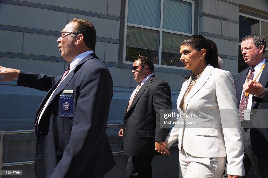 TV personalities Joe Giudice (C) and Teresa Giudice appear in court to face charges of defrauding lenders, illegally obtaining mortgages and other loans as well as allegedly hiding assets and income during a bankruptcy case on July 30, 2013 in Newark, United States.