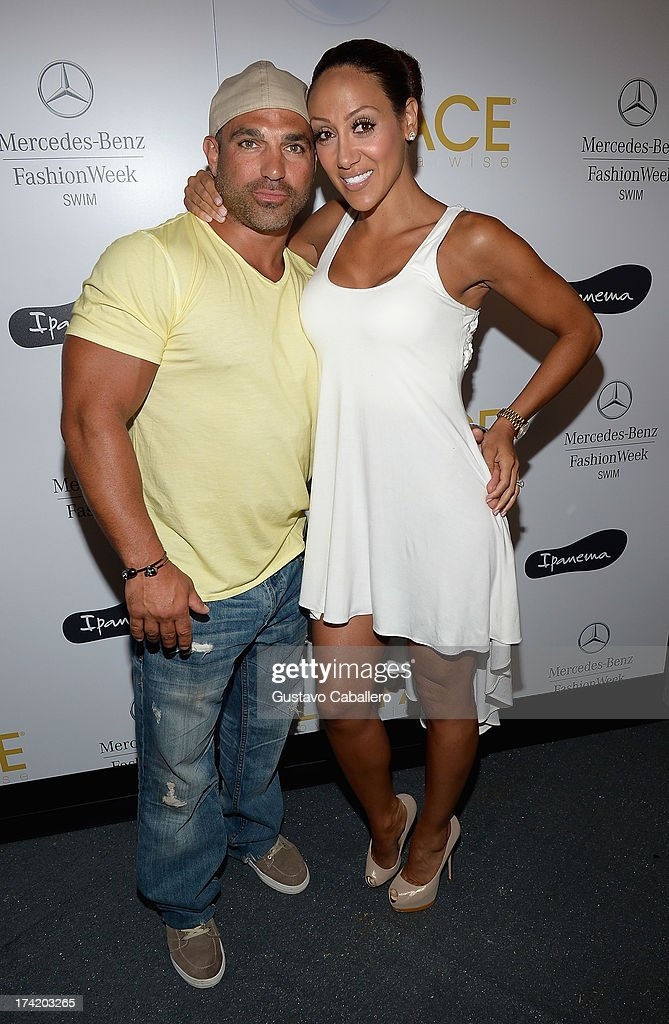 TV personalities Joe Gorga (L) and Melissa Gorga pose backstage with Ipanema at the L*SPACE By Monica Wise show during Mercedes-Benz Fashion Week Swim 2014 at Cabana Grande at the Raleigh on July 21, 2013 in Miami, Florida.