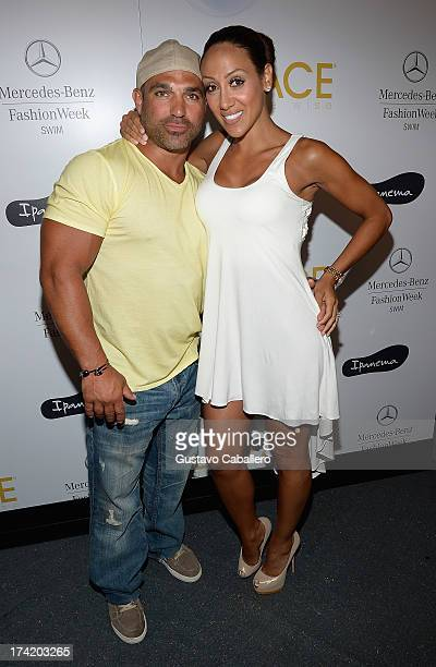 TV personalities Joe Gorga and Melissa Gorga pose backstage with Ipanema at the L*SPACE By Monica Wise show during MercedesBenz Fashion Week Swim...