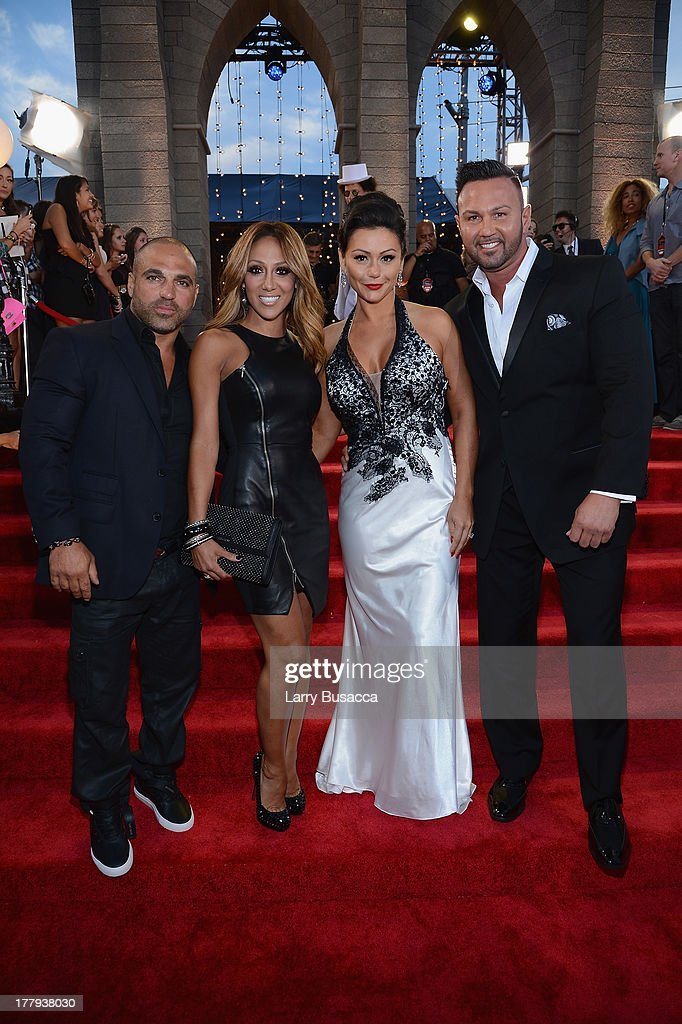 TV personalities Joe Gorga, <a gi-track='captionPersonalityLinkClicked' href=/galleries/search?phrase=Melissa+Gorga&family=editorial&specificpeople=7306775 ng-click='$event.stopPropagation()'>Melissa Gorga</a>, Jenni 'Jwoww' Farley and Roger Mathews attend the 2013 MTV Video Music Awards at the Barclays Center on August 25, 2013 in the Brooklyn borough of New York City.