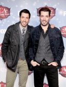 TV personalities Jonathan Scott and Drew Scott arrive at the American Country Awards 2013 at the Mandalay Bay Events Center on December 10 2013 in...