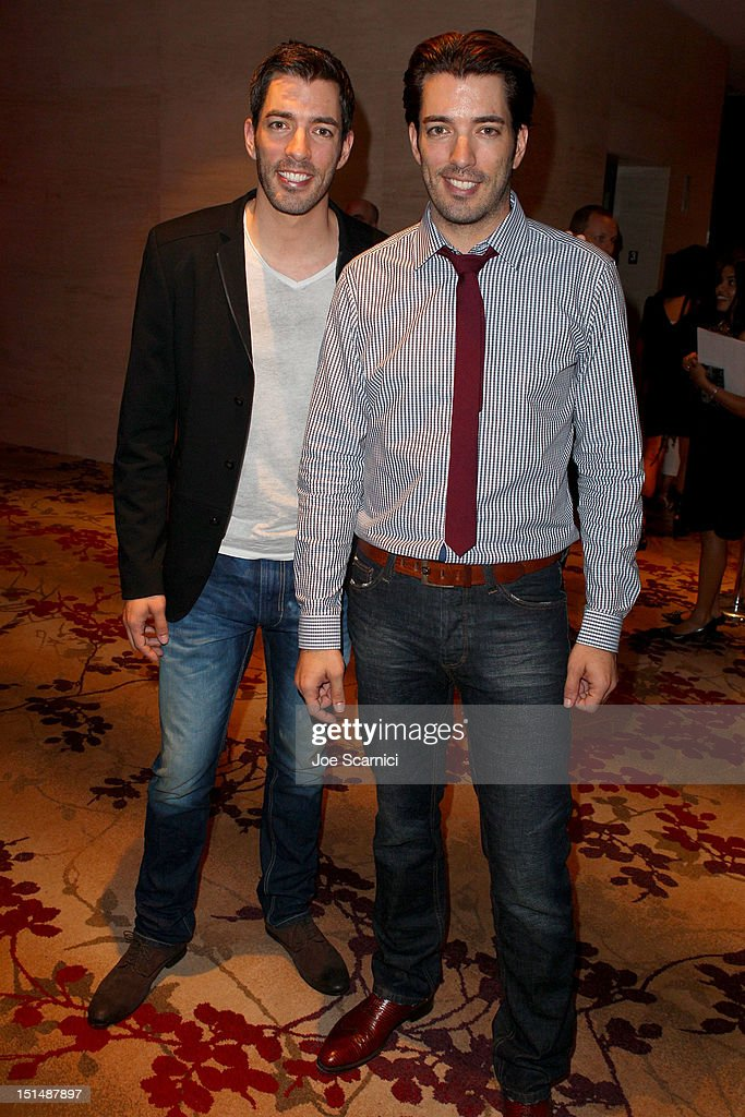 TV personalities Jonathan Silver Scott (L) and Drew Scott attend amfAR Cinema Against AIDS TIFF 2012 during the 2012 Toronto International Film Festival at Shangri-La Hotel on September 7, 2012 in Toronto, Canada.