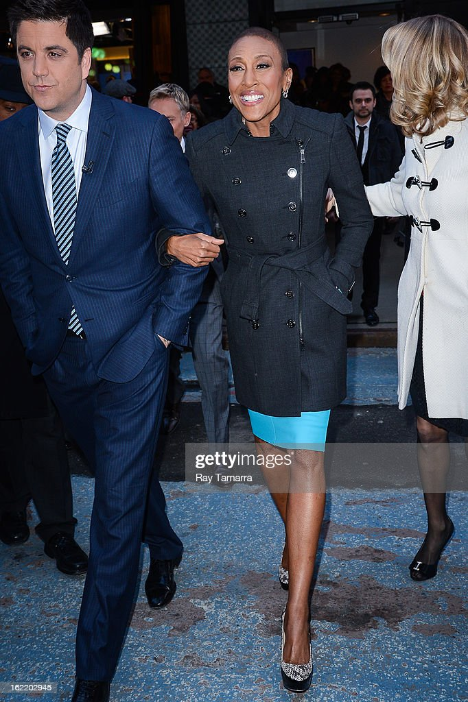 TV personalities Josh Elliott (L) and Robin Roberts enter the 'Good Morning America' taping at ABC Times Square Studios on February 20, 2013 in New York City. Robin Roberts returns to 'Good Morning America' after six month leave for life-saving bone marrow transplant.