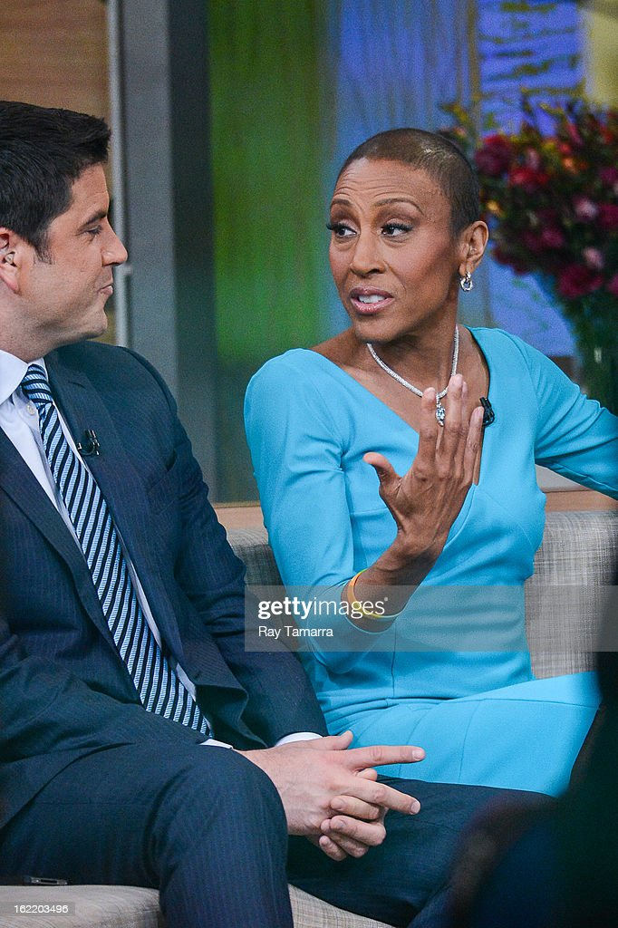 TV personalities Josh Elliott (L) and Robin Roberts host the 'Good Morning America' taping at ABC Times Square Studios on February 20, 2013 in New York City. Robin Roberts returns to 'Good Morning America' after six month leave for life-saving bone marrow transplant.