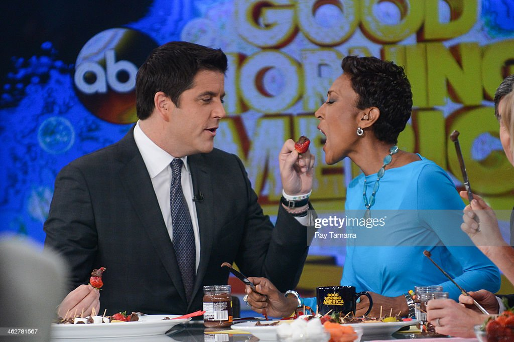TV personalities Josh Elliott (L) and Robin Roberts host the 'Good Morning America' taping at the ABC Times Square Studios on January 15, 2014 in New York City.