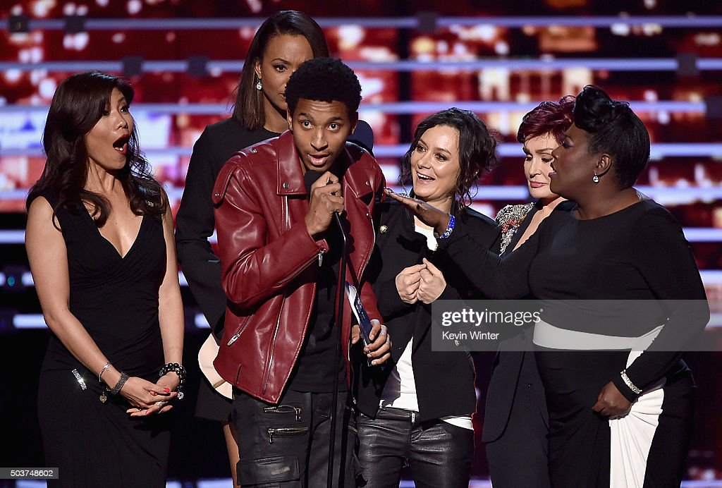 TV personalities Julie Chen, Aisha Tyler, Sara Gilbert, Sharon Osbourne, and Sheryl Underwood are interrupted by an unnamed stage crasher (C) as they accept Favorite Daytime Talk Show Hosting Team for 'The Talk' onstage during the People's Choice Awards 2016 at Microsoft Theater on January 6, 2016 in Los Angeles, California.