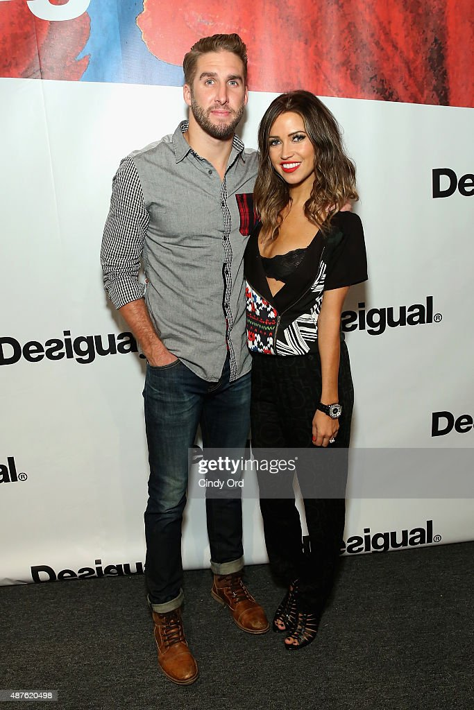 TV personalities Kaitlyn Bristowe and Shawn Booth pose backstage at the Desigual fashion show during Spring 2016 New York Fashion Week: The Shows at The Arc, Skylight at Moynihan Station on September 10, 2015 in New York City.
