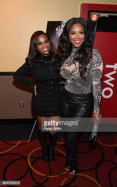 TV personalities Kandi Burruss and Kenya Moore attend 'Fifty Shades Darker' Atlanta screening at AMC Phipps Plaza on February 7 2017 in Atlanta...