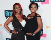 TV personalities Kandi Burruss and Phaedra Parks of 'The Real Housewives of Atlanta' attend the 2013 Bravo Upfront at Pillars 37 Studios on April 3...