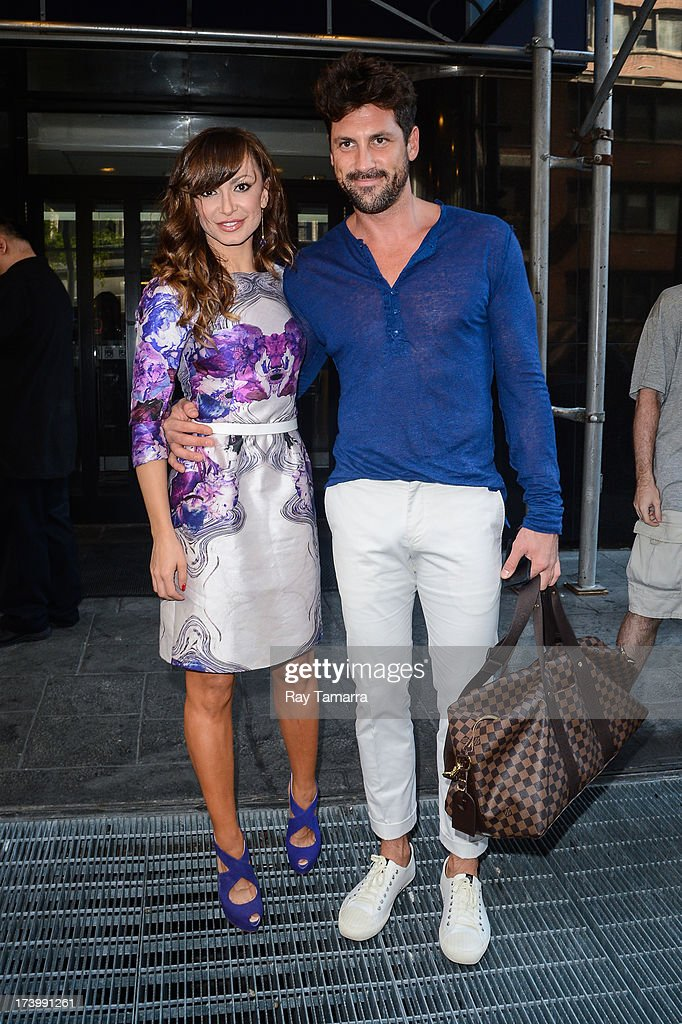 TV personalities Karina Smirnoff (L) and Maksim Chmerkovskiy leave the 'Good Day New York' taping at the Fox 5 Studios on July 18, 2013 in New York City.