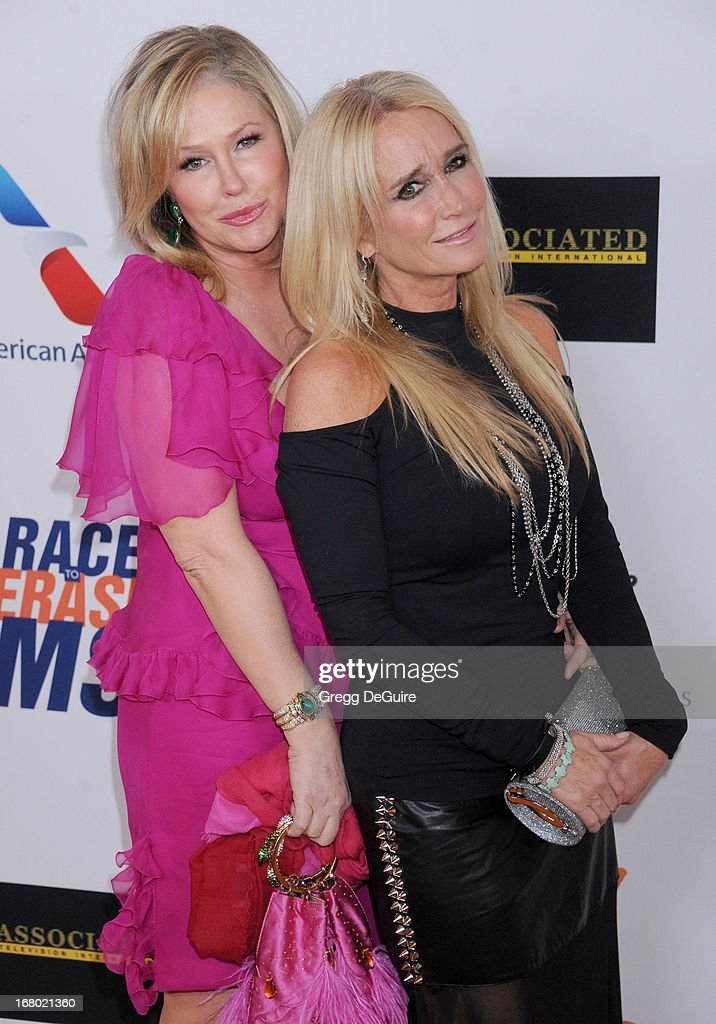 TV personalities Kathy Hilton and Kim Richards arrive at the 20th Annual Race To Erase MS Gala 'Love To Erase MS' at the Hyatt Regency Century Plaza on May 3, 2013 in Century City, California.