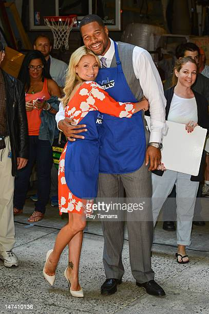 TV personalities Kelly Ripa and Michael Strahan film a segment at the 'Live With Kelly' taping at the ABC Lincoln Center on June 28 2012 in New York...