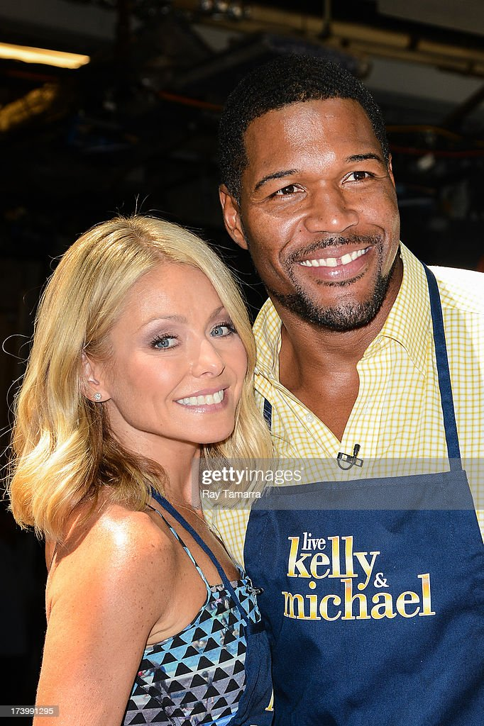 TV personalities <a gi-track='captionPersonalityLinkClicked' href=/galleries/search?phrase=Kelly+Ripa&family=editorial&specificpeople=202134 ng-click='$event.stopPropagation()'>Kelly Ripa</a> (L) and <a gi-track='captionPersonalityLinkClicked' href=/galleries/search?phrase=Michael+Strahan&family=editorial&specificpeople=210563 ng-click='$event.stopPropagation()'>Michael Strahan</a> host the 'Live Wtih Kelly And Michael' taping at the ABC Lincoln Center Studios on July 18, 2013 in New York City.