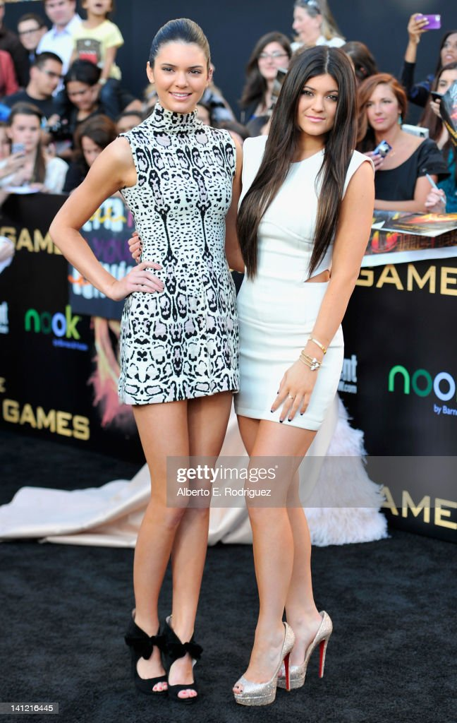 TV personalities Kendall and <a gi-track='captionPersonalityLinkClicked' href=/galleries/search?phrase=Kylie+Jenner&family=editorial&specificpeople=870409 ng-click='$event.stopPropagation()'>Kylie Jenner</a> arrive to the premiere of Lionsgate's 'The Hunger Games' at Nokia Theatre L.A. Live on March 12, 2012 in Los Angeles, California.