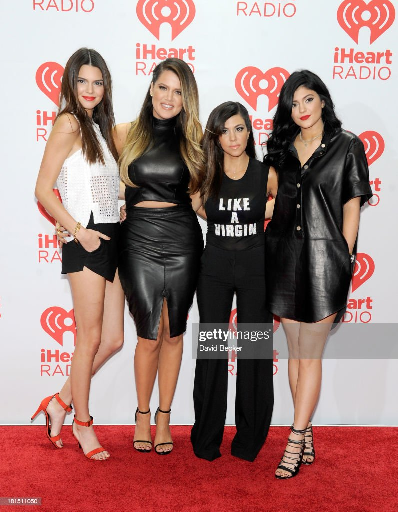 TV personalities Kendall Jenner, Khloe Kardashian, Kourtney Kardashian and Kylie Jenner attend the iHeartRadio Music Festival at the MGM Grand Garden Arena on September 21, 2013 in Las Vegas, Nevada.