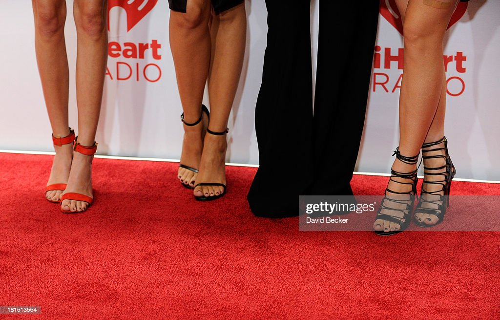 TV personalities Kendall Jenner, Khloe Kardashian, Kourtney Kardashian and Kylie Jenner (shoe detail) attend the iHeartRadio Music Festival at the MGM Grand Garden Arena on September 21, 2013 in Las Vegas, Nevada.