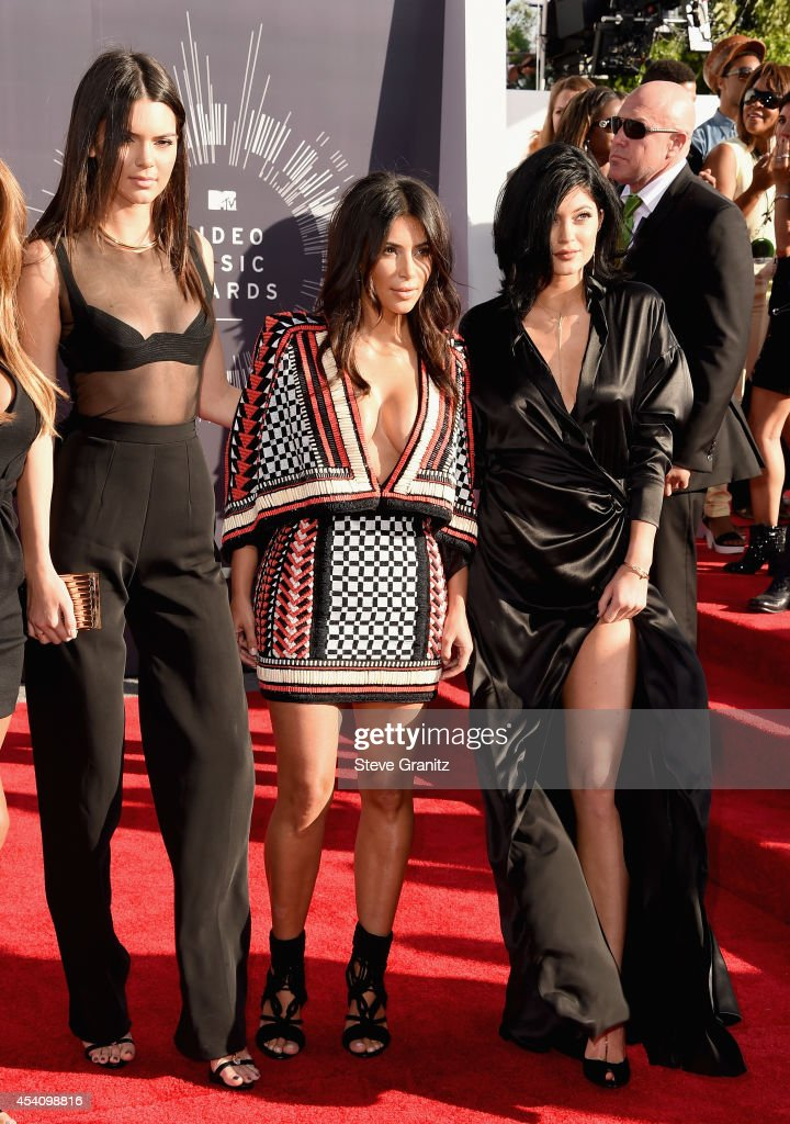 TV personalities Kendall Jenner, Kim Kardashian and Kylie Jenner attend the 2014 MTV Video Music Awards at The Forum on August 24, 2014 in Inglewood, California.