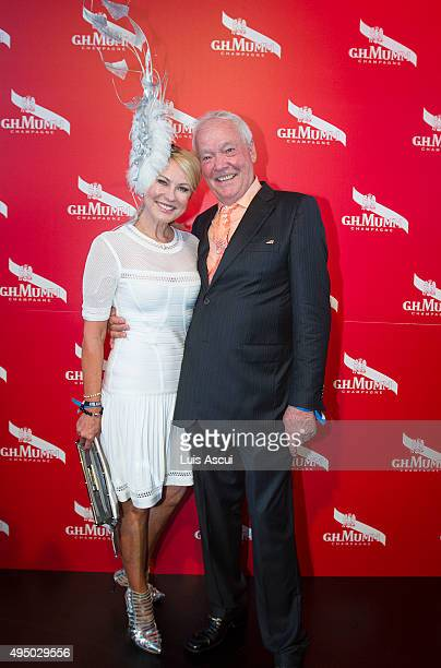 TV personalities KerriAnne Kennerley and John Kennerley pose at the Mumm Marquee on Derby Day at Flemington Racecourse on October 31 2015 in...