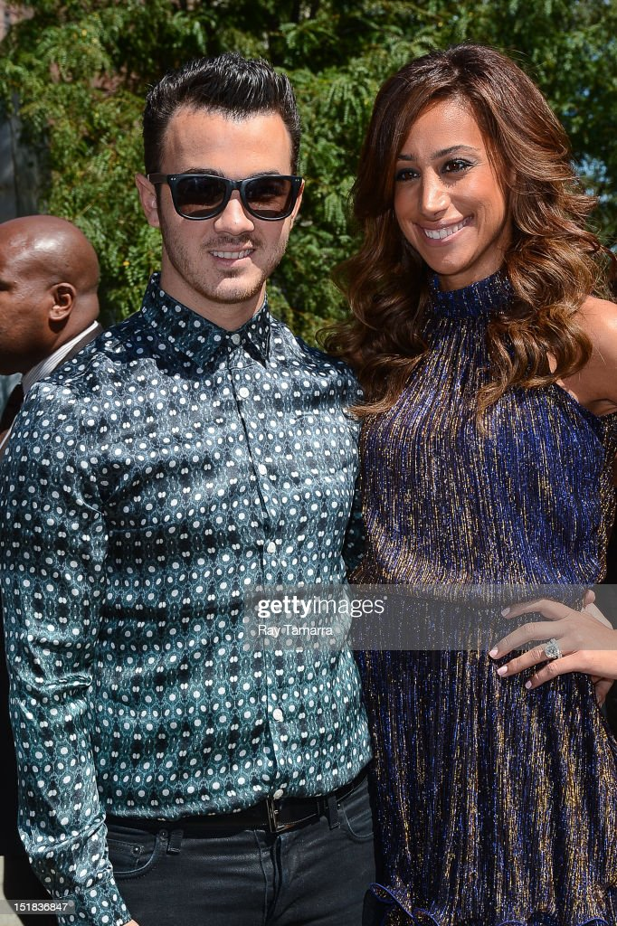 TV personalities Kevin Jonas (L) and Danielle Jonas leave the Mercedes-Benz Fashion Week at Lincoln Center on September 11, 2012 in New York City.