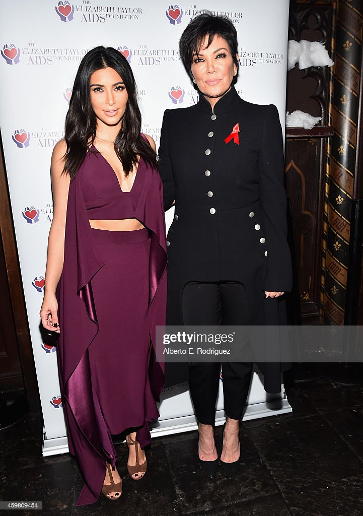 TV personalities Kim Kardashian and Kris Jenner raise a toast for the Elizabeth Taylor AIDS Foundation and World AIDS Day at The Abbey on December 1...