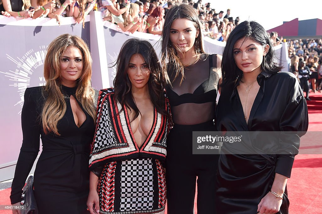 TV personalities <a gi-track='captionPersonalityLinkClicked' href=/galleries/search?phrase=Kim+Kardashian&family=editorial&specificpeople=753387 ng-click='$event.stopPropagation()'>Kim Kardashian</a>, <a gi-track='captionPersonalityLinkClicked' href=/galleries/search?phrase=Kendall+Jenner&family=editorial&specificpeople=2786662 ng-click='$event.stopPropagation()'>Kendall Jenner</a> and <a gi-track='captionPersonalityLinkClicked' href=/galleries/search?phrase=Kylie+Jenner&family=editorial&specificpeople=870409 ng-click='$event.stopPropagation()'>Kylie Jenner</a> attend the 2014 MTV Video Music Awards at The Forum on August 24, 2014 in Inglewood, California.
