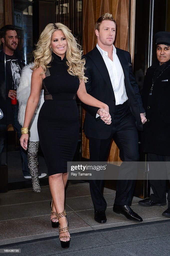 TV personalities Kim Zolciak (L) and Kroy Biermannleaves their Soho hotel on April 3, 2013 in New York City.