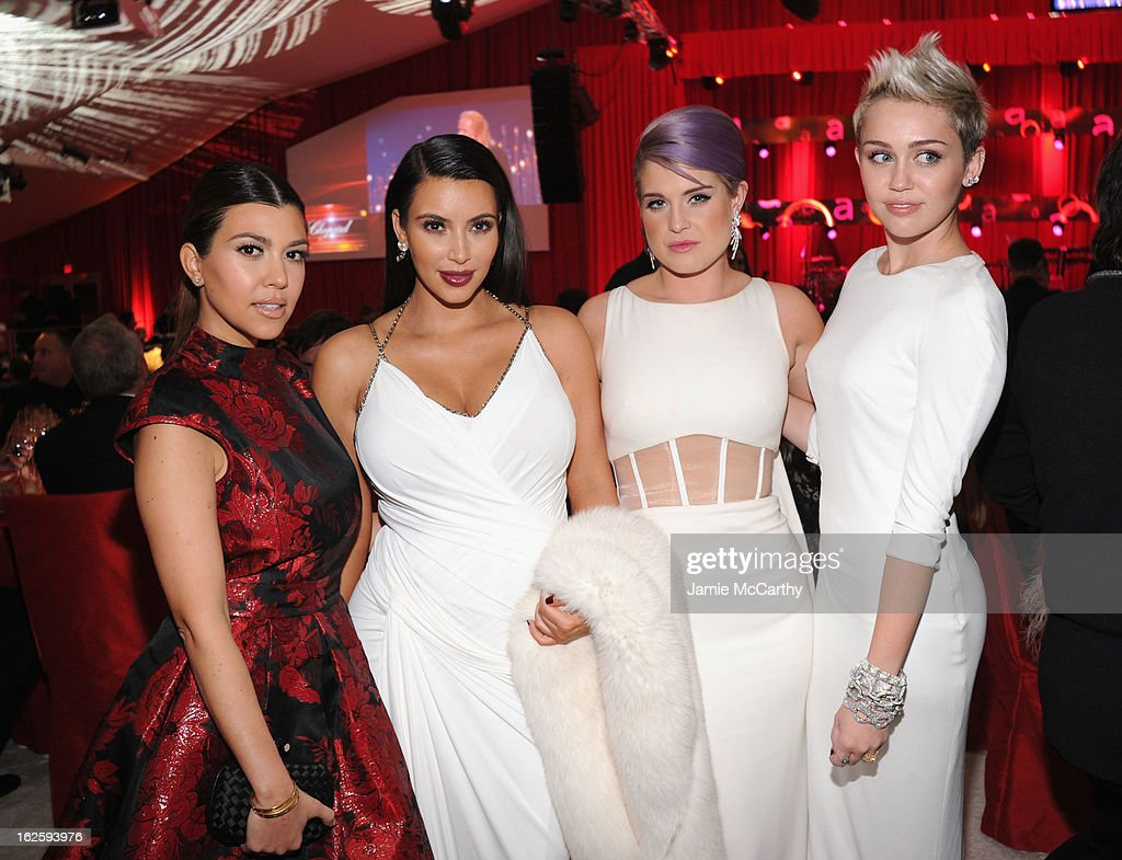 TV Personalities Kourtney Kardashian, Kim Kardashian and Kelly Osbourne and actress/singer Miley Cyrus attend the 21st Annual Elton John AIDS Foundation Academy Awards Viewing Party at West Hollywood Park on February 24, 2013 in West Hollywood, California.