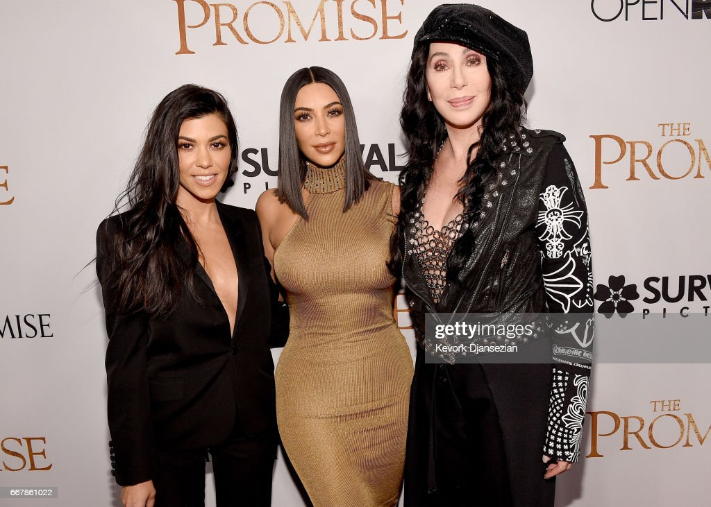 TV personalities Kourtney Kardashian, Kim Kardashian West, and actor/singer Cher attend the premiere of Open Road Films' 'The Promise' at TCL Chinese Theatre on April 12, 2017 in Hollywood, California.