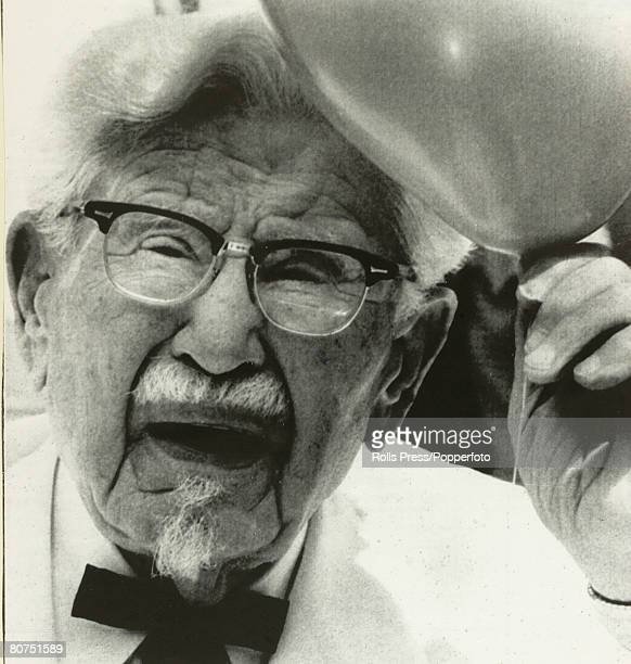 Personalities Louisville USA Col Harland Sanders founder of the Kentucky Fried Chicken empire seen here celebrating his 89th birthday