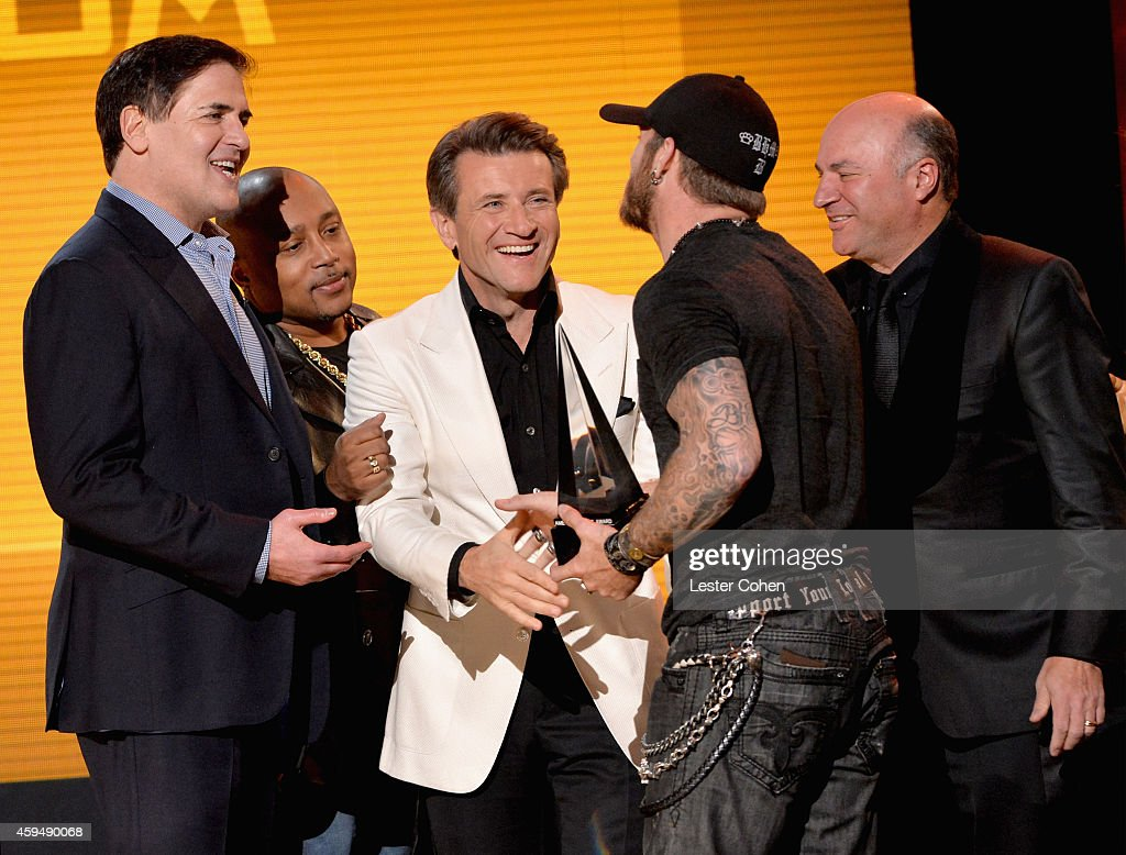 TV personalities Mark Cuban Daymond John Robert Herjavec singer Brantley Gilbert and TV personality Kevin O'Leary speak onstage at the 2014 American...